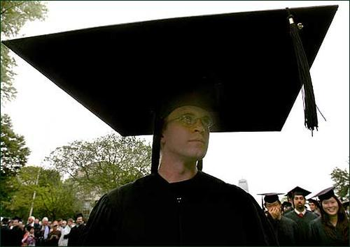 An MIT graduation ceremony, 2006, from Boston.com: 'Another graduate, Ryan Griffin, was prepared in case graduating gave him a big head.' (Globe Staff Photo / David L. Ryan)