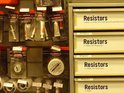The local Radio Shack has a wall of components. Yes, you can buy resistors.