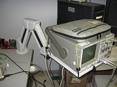 Aubrey Kagan used this computer monitor arm to hold his oscilloscope in 1998.