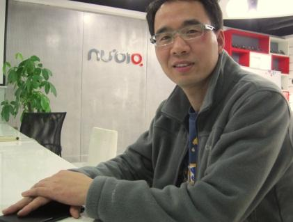 Nubia CEO with his hand covering its yet-to-be-announced Nubia X6. (He showed us the live demo with it, but he didn't want us to photograph it before the official launch.) (Source: EE Times/Junko Yoshida)