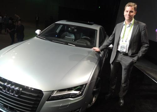 Andreas Reich next to the prototype Audi self-driving car on the San Jose stage at GTC 2014. (Source: EE Times)
