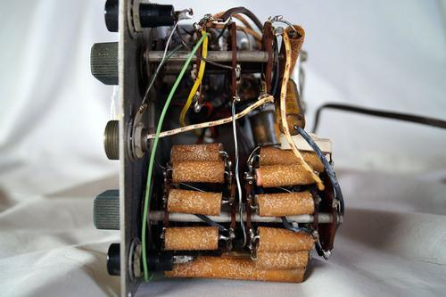 Looking up at the bottom of the unit. A bank of resistors in wax sleeves are visible on the mode dial.