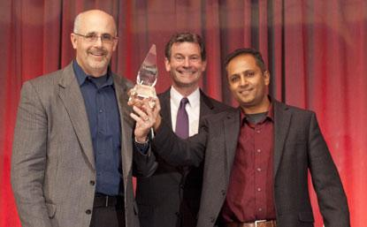 (Left to right): a Micron representative; Greg Waters, CEO of IDT (award sponsor); and Manish Deo, product marketing manage, Altera. Altera/Micron won ACE award for Design Team of Year.