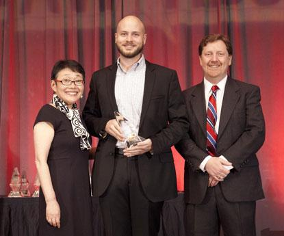 Trey German (center), C2000 software engineer from Texas Instruments accepts the 2014 ACE Award for Open Source Hardware Platform or Application of the Year.
