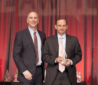 David Doherty (left) Digi-Key and president of the ECIA Foundation gives STEM Impact ACE Award to National Instruments, which won the crowdsourced voting on EE Times. Ray Almgren (right), vice president of Marketing at National Instruments, accepts the award.