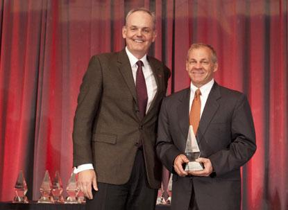 David Anderson (right), CEO and President of Novati Technologies wins ACE Awards' Innovator of Year, 2014. Ian Basey (left), vice president of Global Marketing at Avnet introduced the winner.