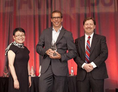 Jerome Nadel (center) senior vice president and chief marketing officer at Rambus accepts 2014 ACE Award for Energy Technology.