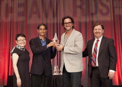 Left to right: Junko Yoshida (EE Times), Sayeed Choudhury (senior director of product management, Internet of Everything, Qualcomm), Gary Brotman (director, Product Management, Qualcomm), Patrick Mannion (UBM Tech); Qualcomm team accepts IoT Technology, Service, or End Application of the Year ACE Award for Qualcomm AllPlay Smart Media Platform.