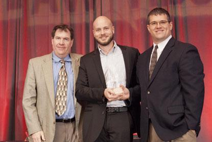 Texas Instruments' Trey German (center) and Jon Beal (right), worldwide marketing manager, accepts the 2014 Ultimate Product ACE Award in Reference Designs for TI's Smart Data Concentrator from Kevin Parmenter, director of Technical Resources, Mouser Electronics.