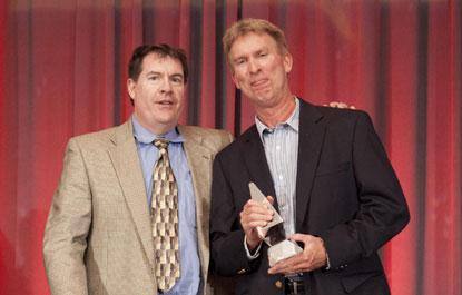 An Agilent Technologies representative (right) accepts 2014 Ultimate Product ACE Award in Test and Measurement Systems and Boards, from Kevin Parmenter, director of Technical Resources, Mouser Electronics.