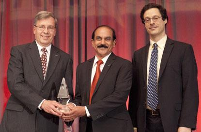 (Left to right) Jim Lajewski, president of Luvata Waterbury and Dr. Hem Kanithi, vice president of Business Development with Luvata Superconductors, accept the ACE Award from IEEE Spectrum's Philip Ross. According to a press release on Luvata's web site, 'Luvata's contributions to the world's most powerful 11.75 Tesla MRI being built by CEA Saclay in France were featured in an IEEE Spectrum article from October 2013.  By producing improved superconducting cables, Luvata unleashes the potential for more powerful MRI scanners with better resolution.  This could open the door for MRIs to detect early indications of brain diseases such as Alzheimer's or Parkinson's and perhaps refine the methods developed to treat those illnesses.'