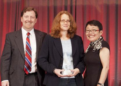 Accepting the first Colin Holland Memorial Journalism Award on behalf of Colin Holland and his family, (left to right) EE Times' Patrick Mannion, Susan Rambo, and Junko Yoshida.
