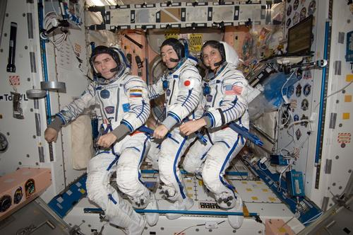 The International Space Station continues to play host to space travelers from around the world despite the limited means of ferrying crews to and from Earth. Here, Russian, Japanese, and American crew members pose in their pressure suits before embarking for home.