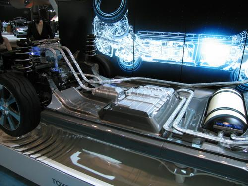 The Toyota FCV, or Fuel Cell Vehicle, is a hydrogen-based concept car that's set to appear in California (where hydrogen refueling stations already exist) in 2015. With an electric motor in the front and hydrogen tank in the back, the car is designed to take in oxygen through the front. It then combines that oxygen with hydrogen to produce fuel in the fuel tank, and emits water vapor as exhaust.  It has a 300-mile range and can recharge in three to five minutes.