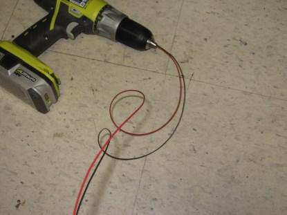 The unruly wires are inserted into the drill chuck, and the chuck is tightened. (Click here for a larger image.)