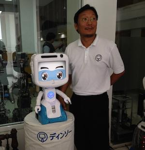 Chalermpon Punnotok, founder and CEO, CT Asia Robotics, with the company's award-winning robot.