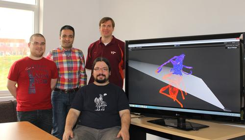 Winning Virginia Tech team members (left to right standing) are Cristian Moral Martos of Madrid, Spain; Mahdi Nabiyouni of Tehran, Iran; Doug Bowman, faculty adviser and professor of computer science at Virginia Tech. Seated is Felipe Bacim of Porto Alegre, Brazil.