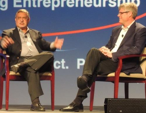 Former AT&T Wireless CEO Mohan Gyani (left) makes a point at the TIE Con keynote with Qualcomm's CEO Steve Mollenkopf.