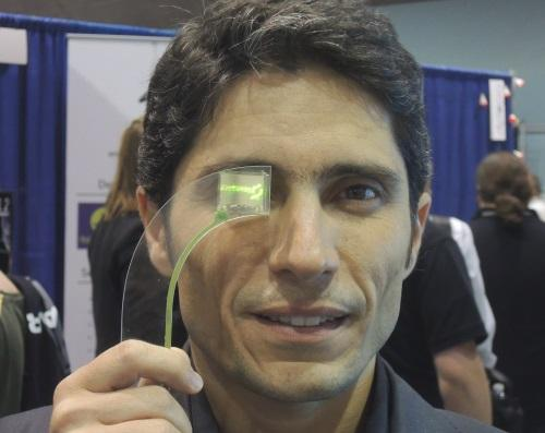 Ivo Yves Vieira, chief executive of LusoSpace (Lisbon) a satellite electronics maker, shows Lisplay, a proof of concept for an 800x600 pixel headset. The company is seeking $2 million to make a full color active-matrix version of its monochrome, passive OLED.