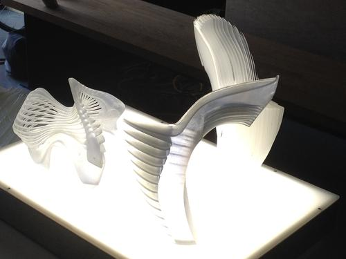 3D-printed models of Anouk Wipprecht's work. Clockwise from left: a shoulder piece that allows for fluid to flow through; half of a smart shoe; another half of a smart shoe, which is part hollow.