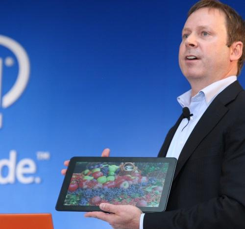 Kirk Skaugen, general manager of Intel's PC client group, holds up the Llama Mountain platform, a fanless mobile PC reference design based on Intel's 14nm Core M processor.