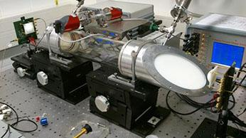 Laboratory setup of 245GHz gas spectroscopy system with the transmitter and receiver module and gas absorption cell. (Source: IHP)