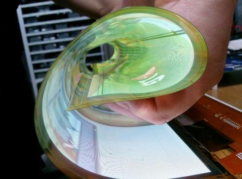 The 18-inch flexible OLED display can be rolled up for storage or transport.(Source: LG)
