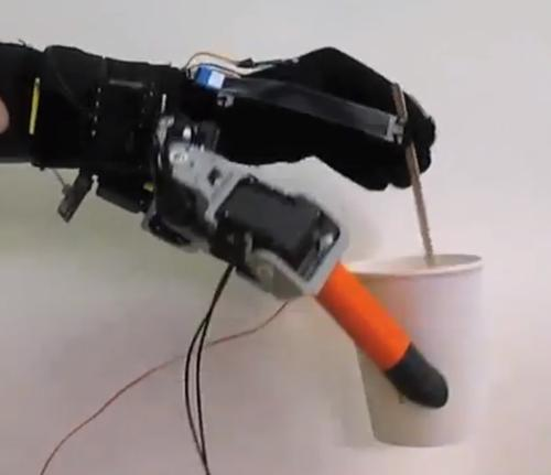 Stirring a drink with one hand is easy if the robotic fingers hold the cup. (Source: MIT)