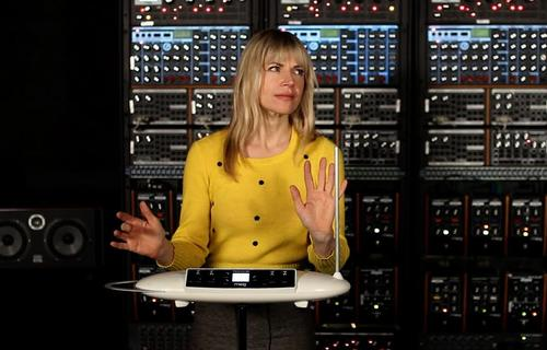 Renowned thereminist Dorit Chrysler playing Moog's Theremini from a bank of music synthesizers.