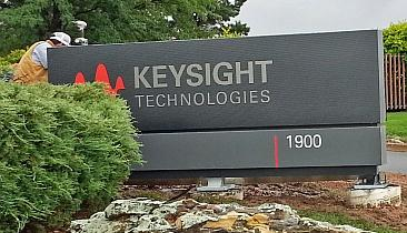 A worker installs the Keysight Technologies sign in Colorado Springs, Colo., home of the oscilloscope division, July 31, 2014.