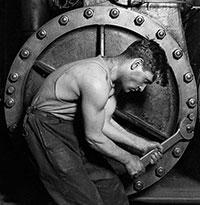 'Power house mechanic working on steam pump.' Lewis Hine, 1920.