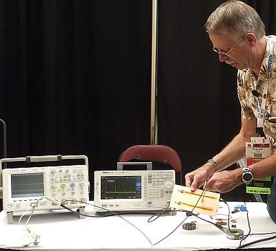 Kenneth Wyatt demonstrates EMC troubleshooting techniques at an IEEE EMC Symposium.