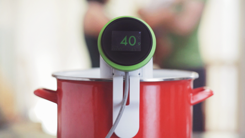 Version 2.0 of Nomiku's sous vide immersion cooker has only three moving parts and a sleeker design than the original, reducing manufacturing costs substantially.
