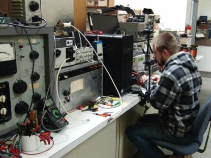 Jason Dueck calibrating analog meters at Instrument Meter Specialties.