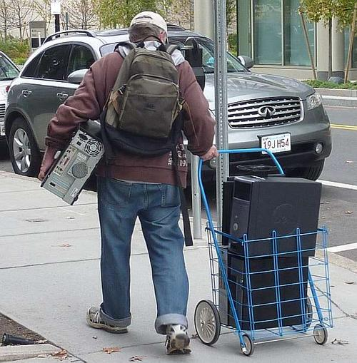 He wasn't carrying test equipment, but he did come prepared with his cart to haul away computers.