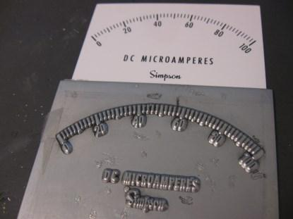 Here's an example of a zinc offset press plate and the corresponding faceplate. I have actually seen these used. (Click here for a larger image.)