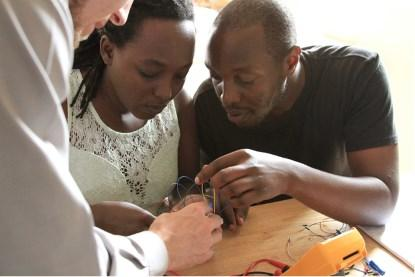 Teaching transistor based logic gates to adult learners in Kampala.