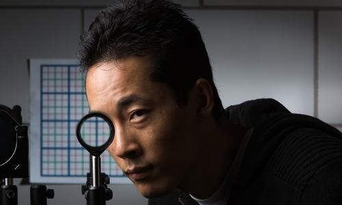 University of Rochester researcher cloak using a special lens--the first invisibility cloak to work in the visible spectrum, according to the researchers. (Source: Adam Fenster, University of Rochester)