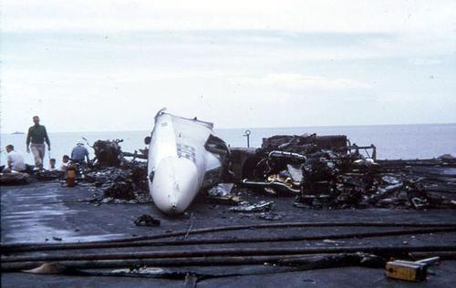 Aftermath of a glitch in the firing system of a jet fighter's missile aboard the USS Forrestal. (Source: Wikipedia)
