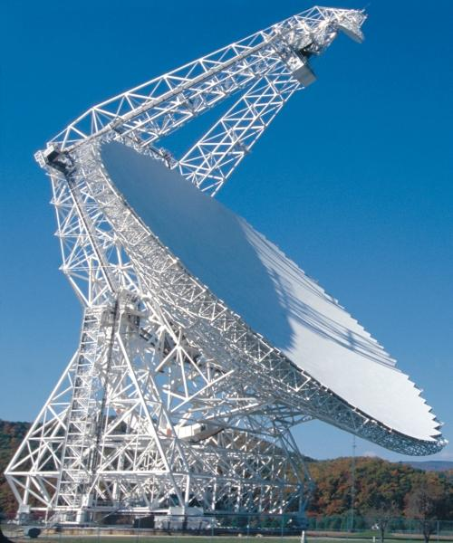The Green Bank Telescope is 485 feet (148 meters) high. It weighs 17 million pounds (7700 metric tonnes) with a dish area of 2.3 acres (1.7 hectares). It is the largest moving structure on land, and the largest fully-steerable telescope in the world (photo provided by NRAO).