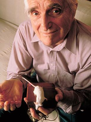 Douglas Englebart, a mouse, and the mouse that made popular computing happen. 