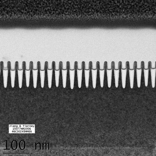 Transmission electron microscope (TEM) image of IBM's 7-nanometer node finned field effect transistors (FinFETs) packed below 30-nanometer fin pitch using self aligned patterning.