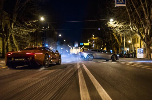 The Jaguar C-X75 was painted reddish for the chase scene with 007's Aston Martin DB-10 in the lead. (Source: Columbia Pictures)