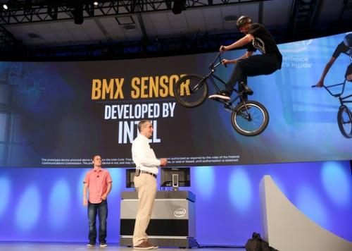 In a keynote filled with theatrics and geared to attract young developers, Intel CEO Krzanich let a Curie-instrumented BMX biker leap over him on stage. (Photo: Intel)