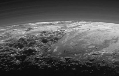 A detail view of the sunset on Pluto shows rugged mountains up to 11,000 feet high (courtesy NASA).