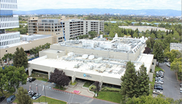 Apple is buying a former Maxim fab (above). (Image: Google and SV Business Journal)