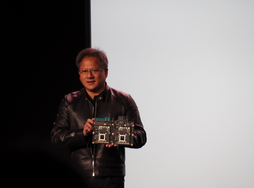 Jen-Hsun Huang holding the NVIDIA DRIVE PX 2. (Photo credit: Kevin Krewell, Tirias Research)