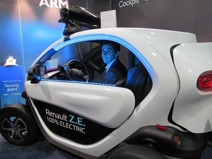 Renault's Pierre Delaigue inside Twizy at ARM's booth