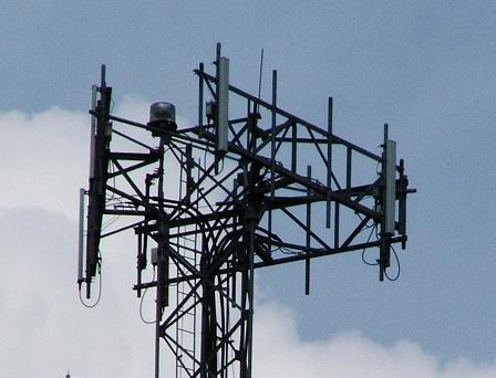 Signals from cell towers have difficulty penetrating into buildings and are positioned to favor ground coverage.