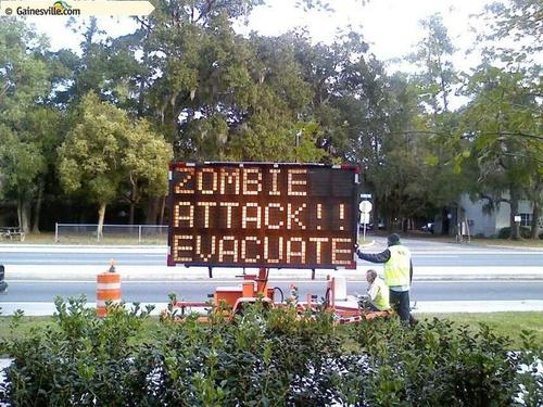 Portable traffic signs have come under attack from zombie-loving hackers.